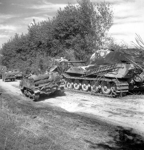 A German Tiger 2 tank abandoned on the road to Vimoutiers, France.