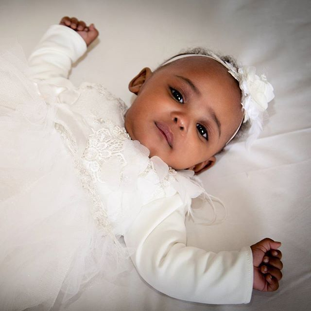 Beautiful baby girl in a custom Amahle dress and headband for her #christening #kidsdesigner brand