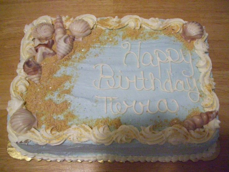 seashell birthday cake - This cake was done for my daughters best friend who loves the beach.   The cake is 1/4 sheet white with buttercream icing and the seashells are chocolate molds (marbled).  Sand is graham cracker crumbs and wilton sugar crystals.