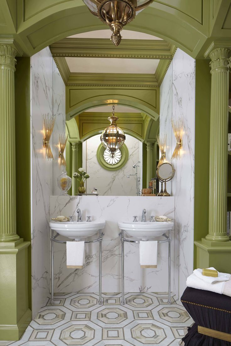 His-and-hers vanity space featuring the St. George lavatory and console sink, lighting pendants by Hudson Valley Lighting and sconces by Kelly Wearstler for Visual Comfort.