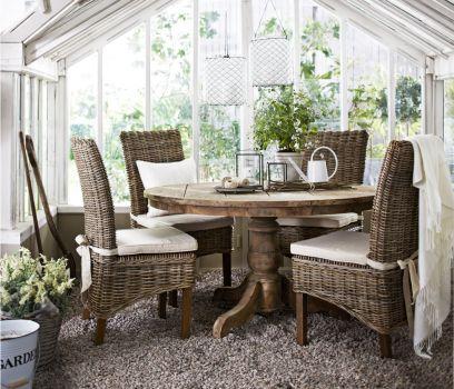 Round teak table (Mio.se)