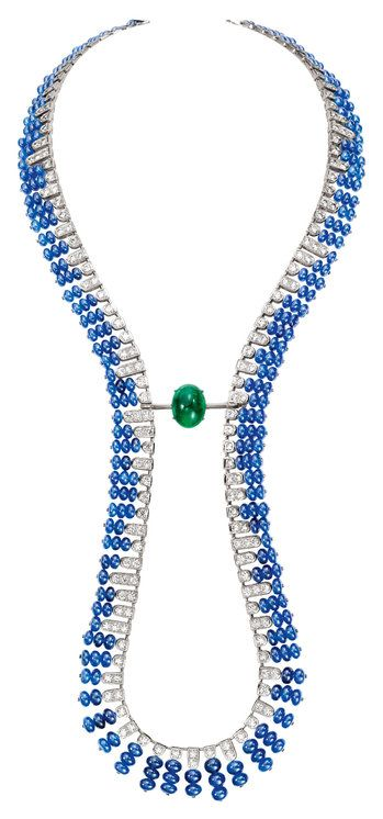 Boucheron Beau Rivage necklace. Centering on a emerald cabochon, it is 18k white gold set with blue sapphire beads and faceted diamonds. Like the Isola Bella piece and most of the other necklaces, this one is convertable, with the set emerald removable to wear as a brooch
