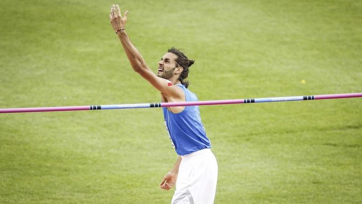 epa05418909 Gianmarco Tamberi of Italy reacts during the High Jump Men Final of the European Athletics Championships at the Olympic Stadium in Amsterdam, Netherlands, 10 July 2016.  EPA/KOEN VAN WEEL