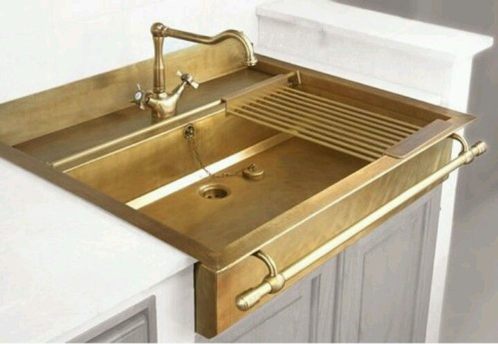 This brass sink is amazing!! Would especially be pretty with natural woods and black and white. ❤️                                                                                                                                                     More