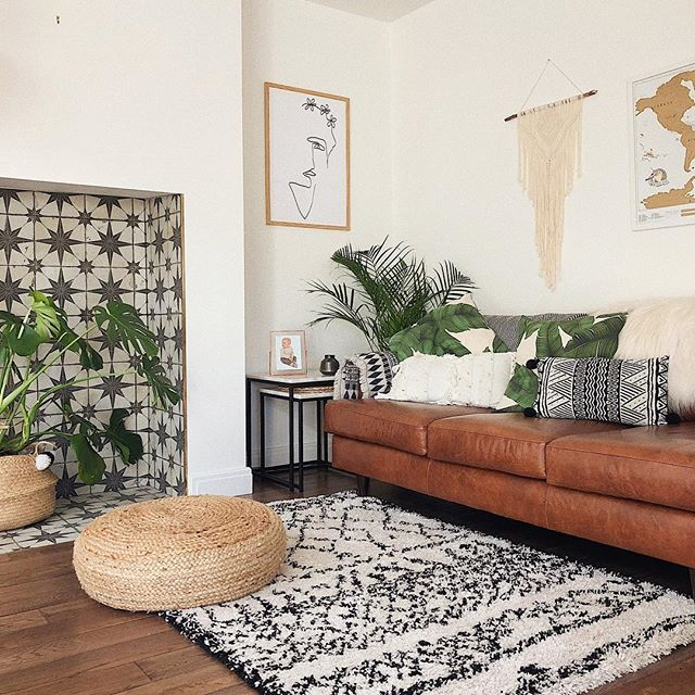 Monochrome Living Room With Brown Leather Sofa Tiling In The Fireplace And Boho Accents Li Monochrome Living Room Living Room Leather Brown Living Room Decor