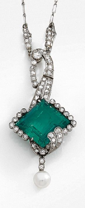 An early Art Deco platinum, diamond, emerald and pearl pendant, circa 1910. #ArtDeco