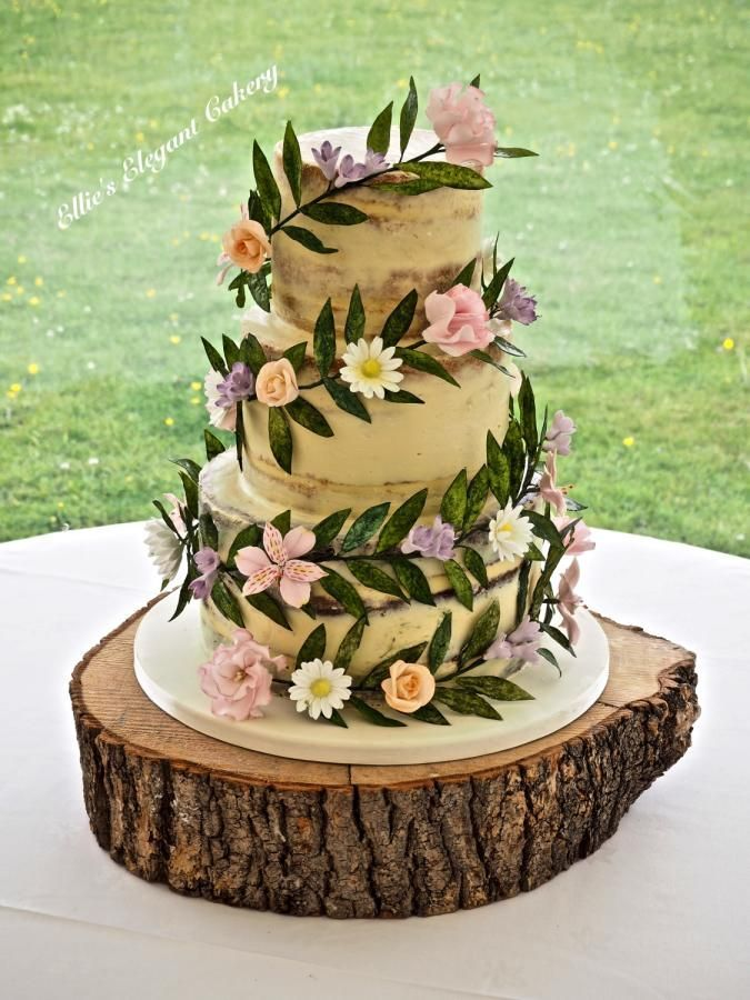 Floral Garland wedding cake by Ellie @ Ellie's Elegant Cakery - http://cakesdecor.com/cakes/281487-floral-garland-wedding-cake
