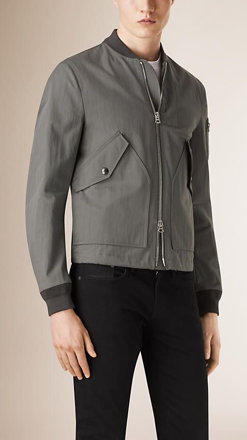 Burberry Dark Grey Cotton Blend Bomber Jacket - A protective cotton-blend bomber jacket with a heritage-inspired pen pocket on the arm. The design features a tonal topstitch at the front zip guard and oversize utility pockets. Discover the men's outerwear collection at Burberry.com