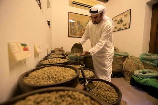 """Mr Al Mulla, right, shows his collection of #coffeebeans from around the #world. """"You will love #coffee even more after visiting the #museum and understanding its #history and #cultural relevance to us and the other cultures,"""" he says. Ravindranath K / The National  #CoffeeHistory #Dubai #UAE #CoffeeMuseum"""