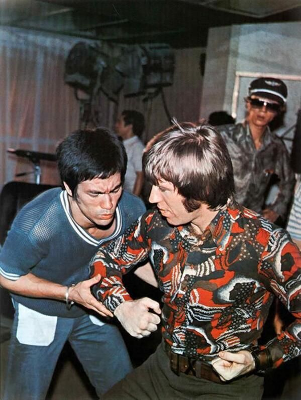 "Bruce Lee and Chuck Norris behind the scenes of ""Way of the Dragon."""