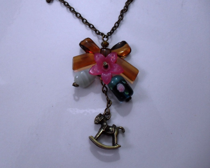 rocking horse necklace.-  lampwok, acrilyc and lucite  rocking horse charm     more: https://www.facebook.com/pages/Accesorios-Pekados/272785662745808
