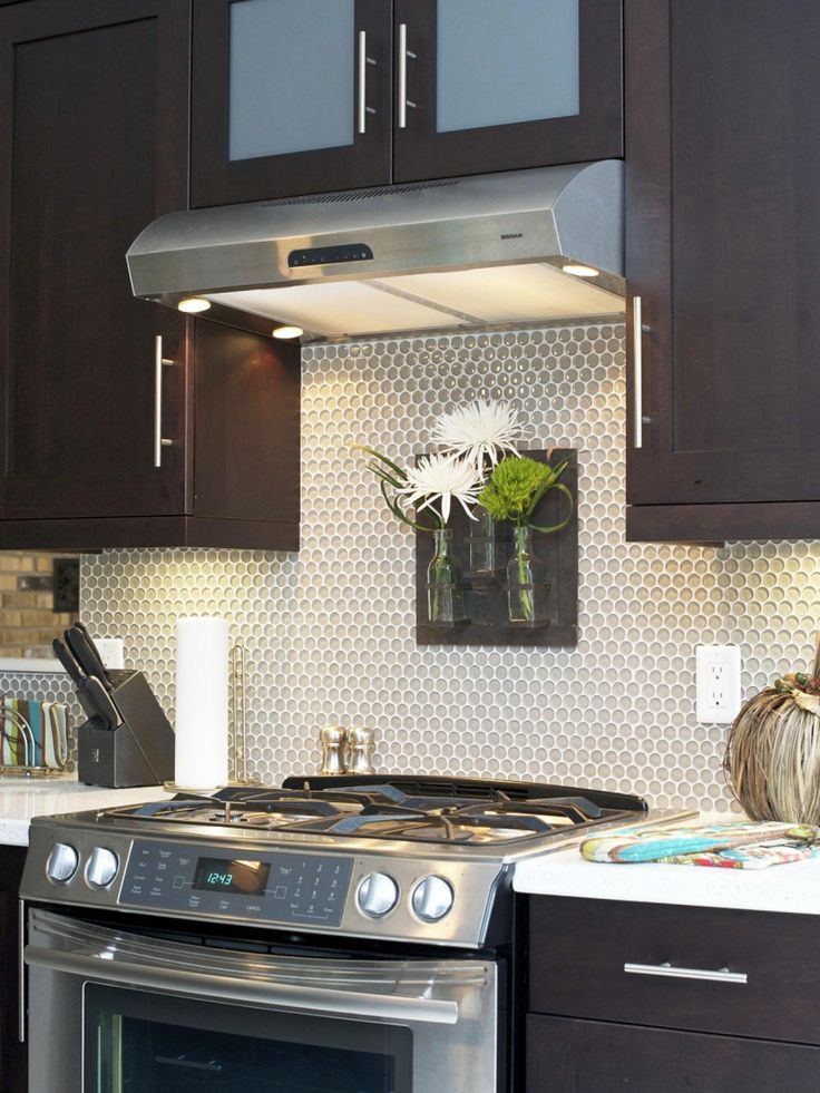 A glass penny tile backsplash adds pop art punch