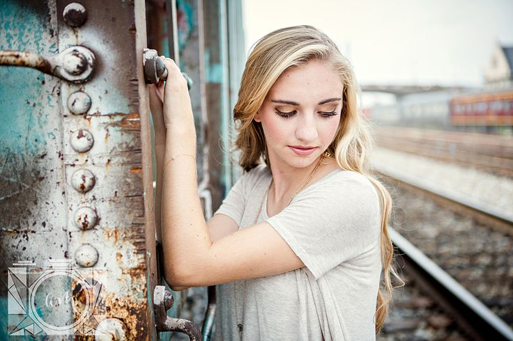Holding onto train senior pictures in downtown knoxville by Amanda May Photos