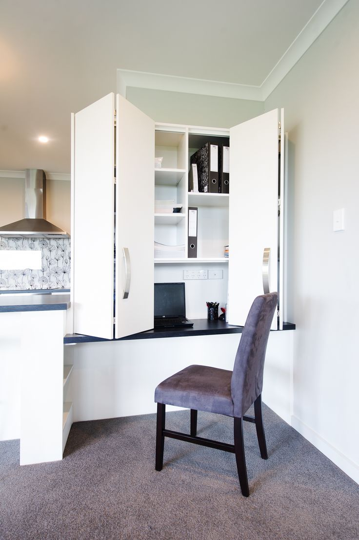 A handy work space or study nook is positioned at the end of the kitchen bench