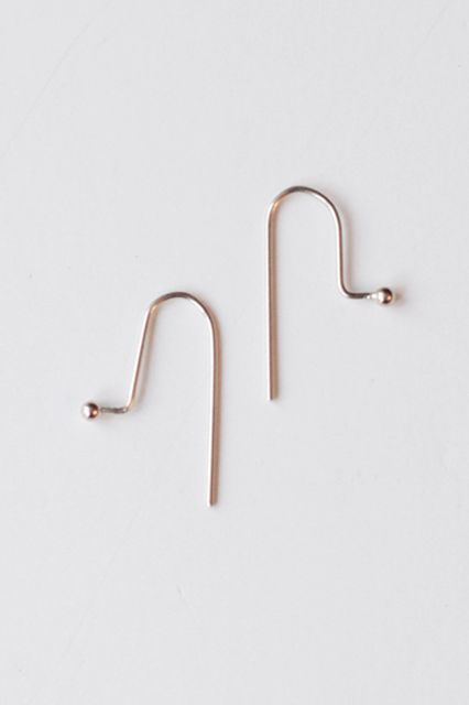Naked Jewelry? Yes, It's A Thing & You'll Want To Try It #refinery29  http://www.refinery29.com/barely-there-jewelry#slide-11  Slide these bent-strand earrings through your piercings (with the knobs facing forward) for a structured and very subtle statement. ...