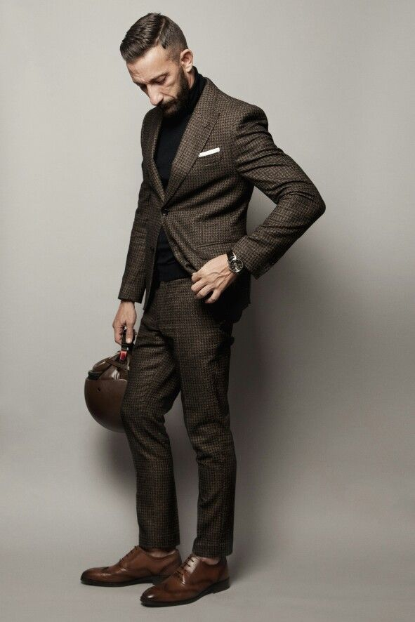 Tweed suit, Daniele Alessandrini Leather helmet Massimo Dutti
