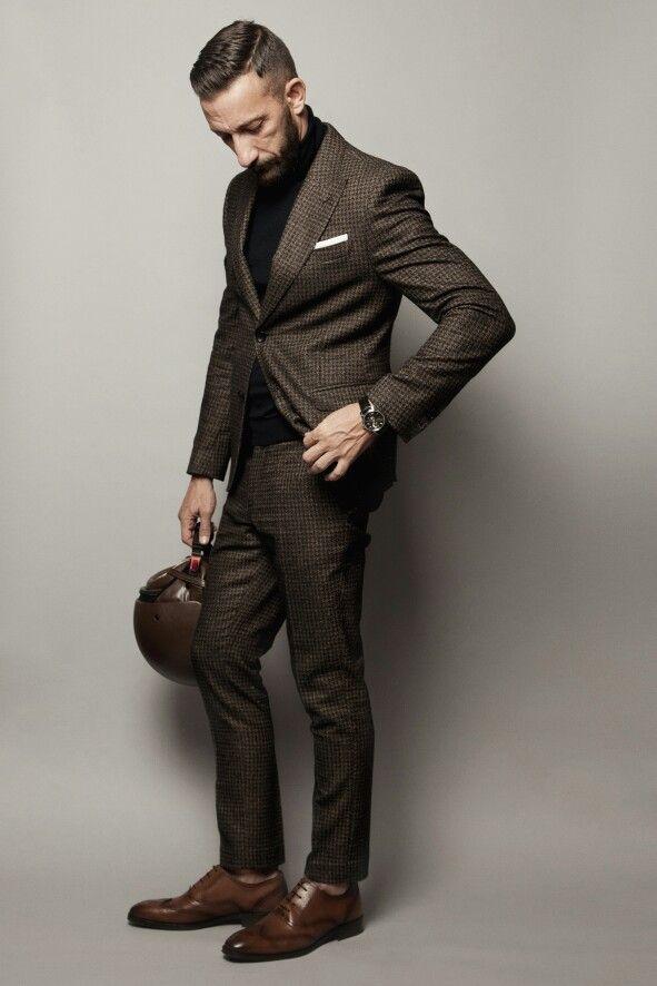 Tweed suit, Daniele Alessandrini Leather helmet Massimo Dutti