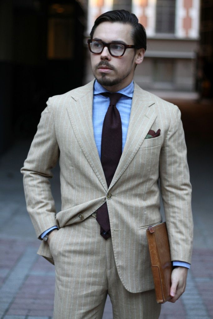 Light colored chalk stripe flannel suit with brown wool tie