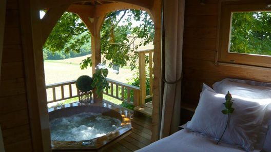 view from a treehouse, yes thats a hot tub