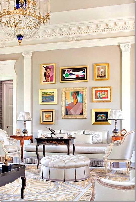 Great example of mix and match that works! Though the frames are all different, the gold ties them together. Your eyes can't help but be drawn to all the colorful #framed #art.
