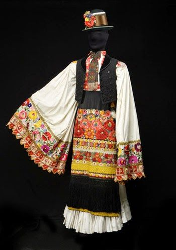 Unusually, the men wear essentially the same apron. It is very common for Hungarian men's costumes to include an apron, but they are usually different from the women's