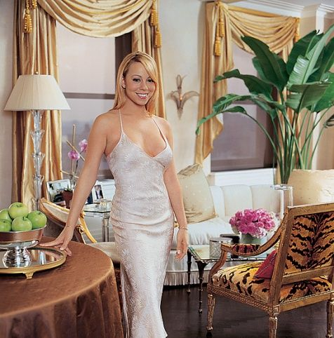 "Home of Mariah Carey, Glitter and Glamour Sound a High Note in the Singer's New York Triplex  Interior Design by Mario Buatta  Photography by Scott Frances  Published November 2001 The platinum-selling singer in the living room of her New York City triplex. ""This apartment was basically a raw space,"" explains interior designer Mario Buatta. ""The Art Déco influence came from the architecture of the building, which was erected during that period."""