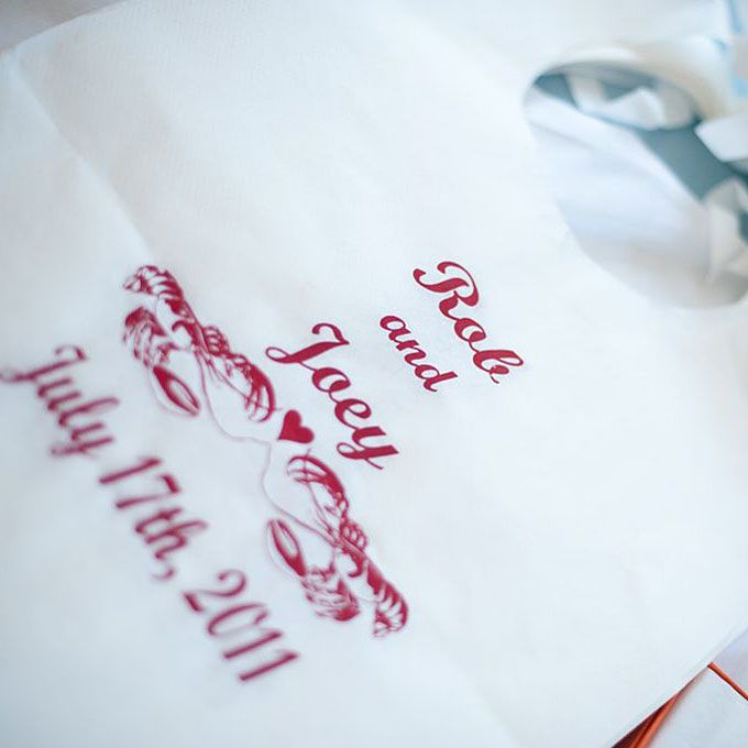 Guests were given customized lobster bibs printed with the couple's names and wedding date, photo: Mathew Kiang.