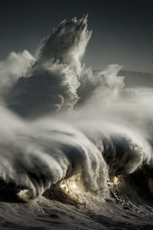 El faro by Ricardo Lopez Blanco. Large waves pounding lighthouse, Mouro island, Santander, Spain