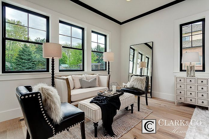 """Clark & Co Homes - 2016 Spring Parade Home """"The Heartland"""". Modern Farmhouse. www.clarkandcohomes.com. Built-in cabinetry; White Dove by Benjamin Moore; Black Magic. Master bedroom sitting room. Impervia windows by Pella. Shaw white oak engineered flooring. Black crown molding."""