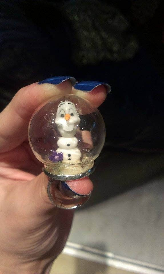 polymer clay glass bubble ring. Inside lives Olaf the snowman from Disney's animated feature film Frozen.
