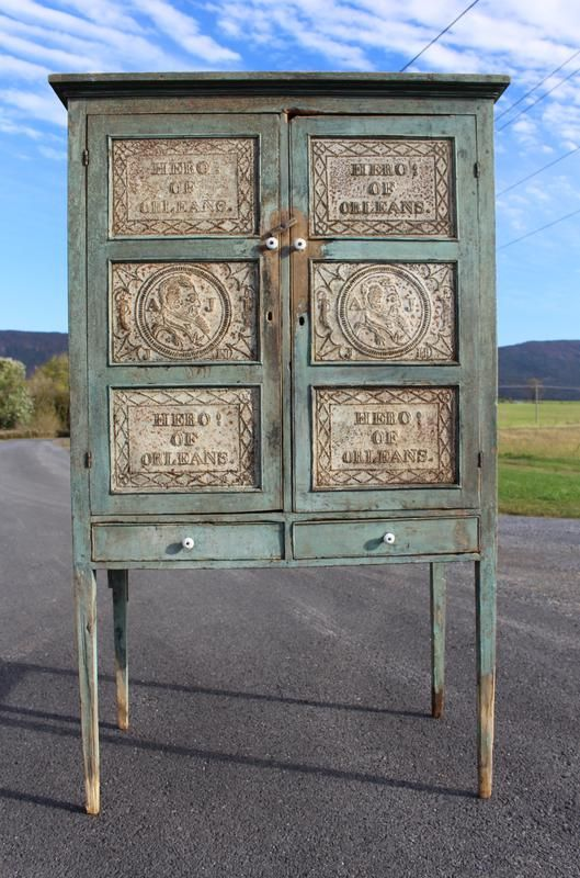 """A pie safe in blue paint with 12 tins, featuring the profile of Andrew Jackson, the owner's name, """"Hero! of Orleans,"""" and more, sold for $102,500 (no buyer's premium charged) at the July 19 sale by Nicely's Auction in Clifton Forge, Virginia.The pie safe was made by Matthew S. Kahle (1800-1869), a Pennsylvania-born cabinetmaker of Lexington, Virginia, sometime between 1824 and 1828. (Lexington is about 30 miles from Clifton Forge, Virginia.)"""
