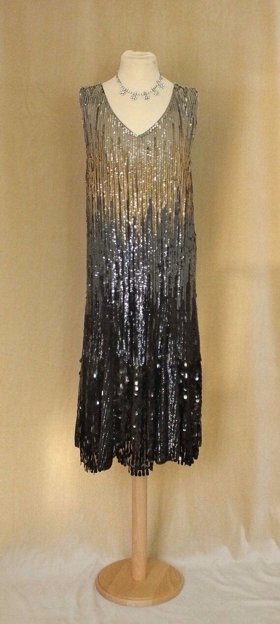 Gorgeous original 1920's beaded dress in black/silver and gold. Its lovely bit also pricey at over £200!- from Etsy