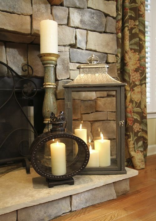 Love this grouping of lanterns & candles in front of fireplace!!