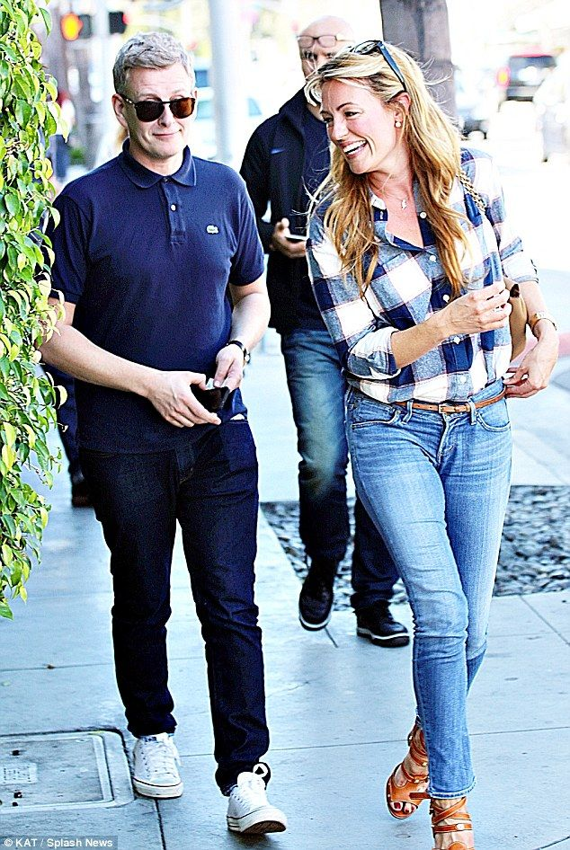 Tickled pink: Cat Deeley seemed unable to contain her giggles as she exploded into a fit of laughter while enjoying a lunch date with husband Patrick Kielty in West Hollywood on Tuesday