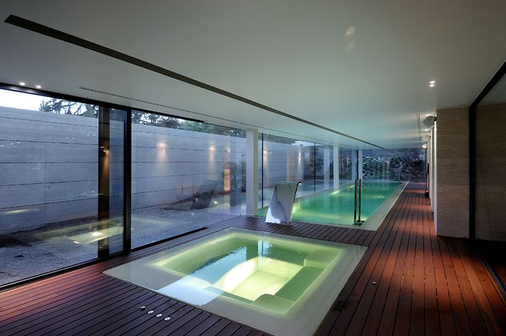 Really cool pool and hot tub...House in Las Rozas by A-cero Architects. I want this exercise pool and relaxing jaccuzi