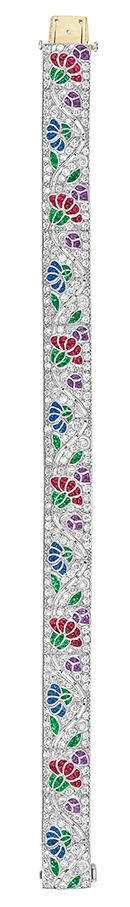 Diamond and Gem-Set Bracelet   Platinum, the straightline strap centering a pierced curving openwork vine flanked by alternating flowers set with buff-topped cabochon rubies, sapphires, emeralds and amethysts. Art Deco or Art Deco style.