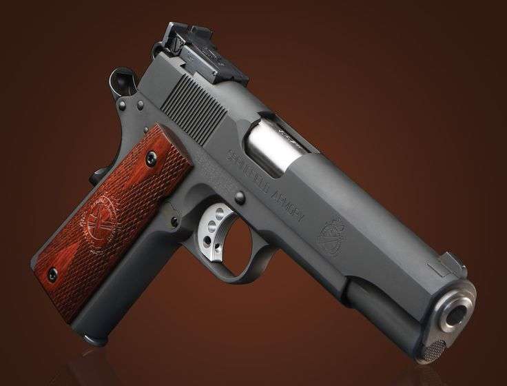 Springfield Armory 1911 9mm Range Officer - Don't forget that it comes with a serviceable holster, a double magazine pouch, an extra magazine and a really good hard-exterior carrying case that provides great protection to it when traveling.  MSRP $977.00, but have seen some selling for around $800.00