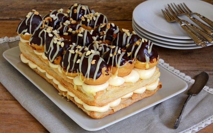 La ricetta della torta profiteroles è perfetta come torta di compleanno. Un dolce da montare con bignè, pasta sfoglia, crema pasticcera e glassa al cioccolato. Supergoloso!