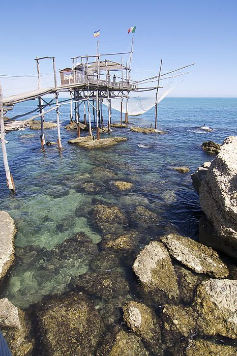 Abruzzo in Italy has lots of these lovely fishing platforms, and look at that transparent water #photo on Pinterest