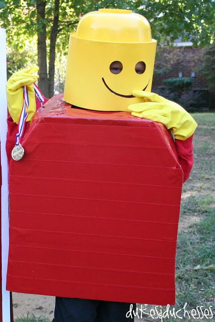 Luke loved this Lego Man costume when he saw it but it seemed extremely complicated and expensive to make. I decided I could make it for less than ten dollars and I did. I found a bowl at the dollar store, spray painted it yellow, then cut yellow poster board to size, cut the face …