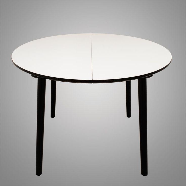 Rundt spisebord med udtræk her vist uden isat tillægsplader. og ...