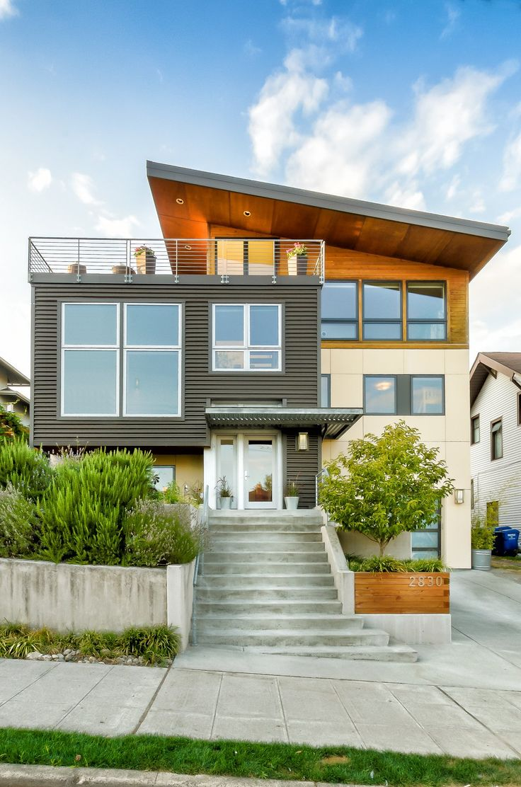 What a great rooftop deck and modern exterior! Ballard Remodel by  Grouparchitect- Fantastic! A non-descript split level home becomes a modern  showpiece.