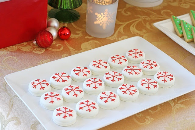 Dipped oreos decorated as snowflakes