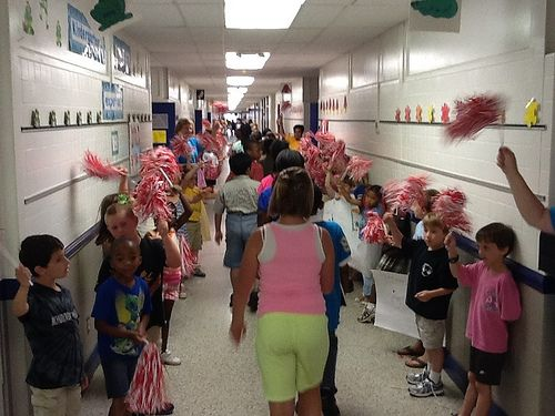 Fifth graders take a final walk down each hall on their last day of school. What a great idea!