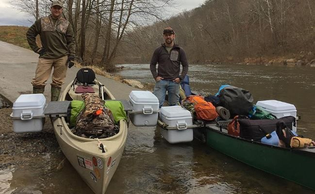 Wingman Outfitter design and manufacture custom canoe outriggers using coolers for stability.