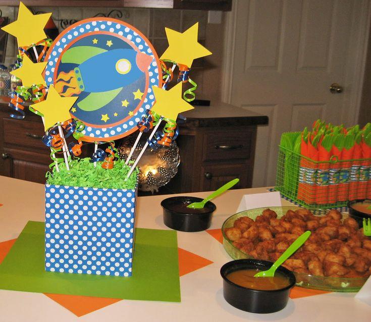 Napkin holders around utensils space themed birthday