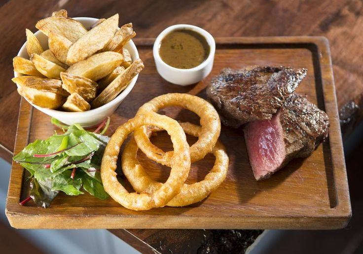 Steak and Chips with pepper sauce and onion rings