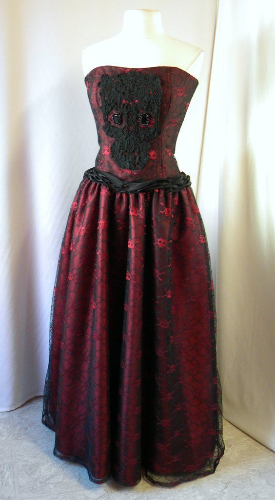 Fancy and creepy, a great formal dress combination of features, the large black applique over a skull lace print gown is princess style in Gothic and Halloween theme for proms and parties. #Gothic #Prom #Dresses #Halloween #Unusual