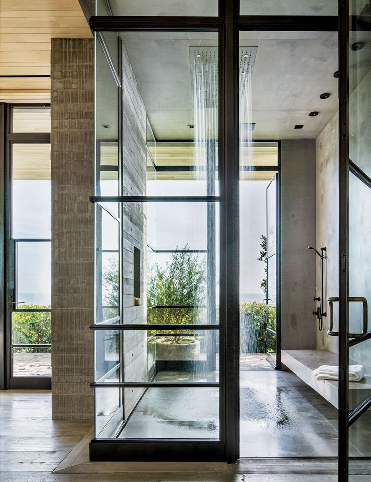 A Malibu, California, master bath features a Dornbracht rain-shower system that's open to the the elements. The concept was conceived by architect Scott Mitchell and designer Denise Kuriger.