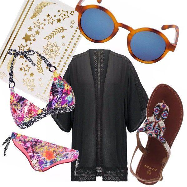 Per un'estate da urlo: bikini sgargiante, mantella nera con ricami, tattoo temporanei gold e sandali in stile boho. Indispensabile a completare il look gli occhiali da sole specchiati.
